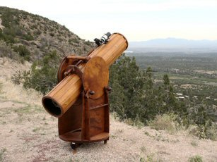 Wooden Telescope Overlooking Mountains